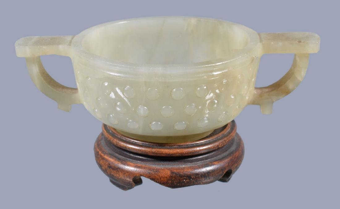 A Chinese small celadon jade two-handled bowl, Qing