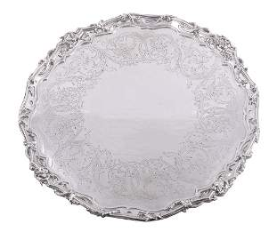 A Victorian silver shaped circular large salver by John