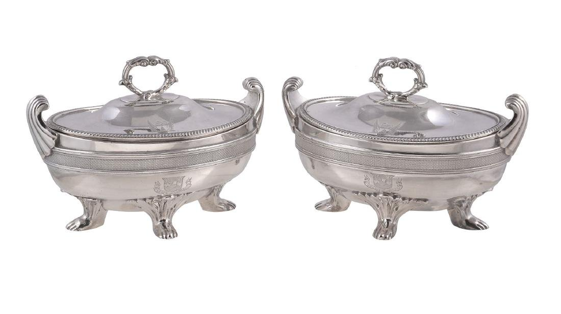 A pair of George III silver oval sauce tureens and