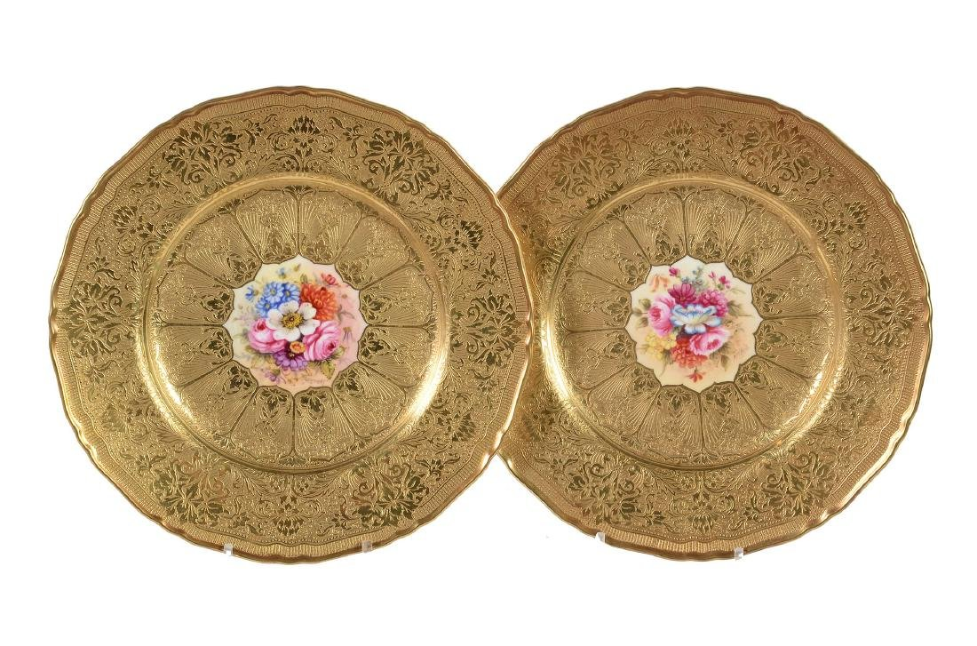 A pair of Royal Worcester plates signed by Freeman and