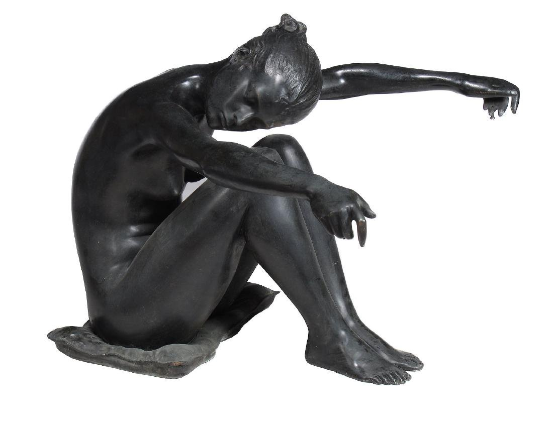 A bronze figure of a seated nude as a coffee table,