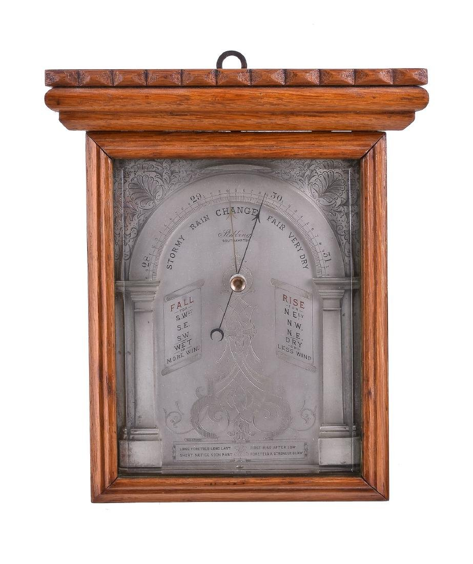 An unusual oak cased aneroid wall barometer possibly