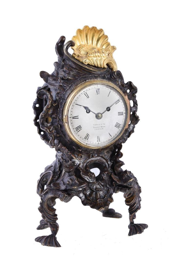 A George IV gilt and patinated bronze rococo style