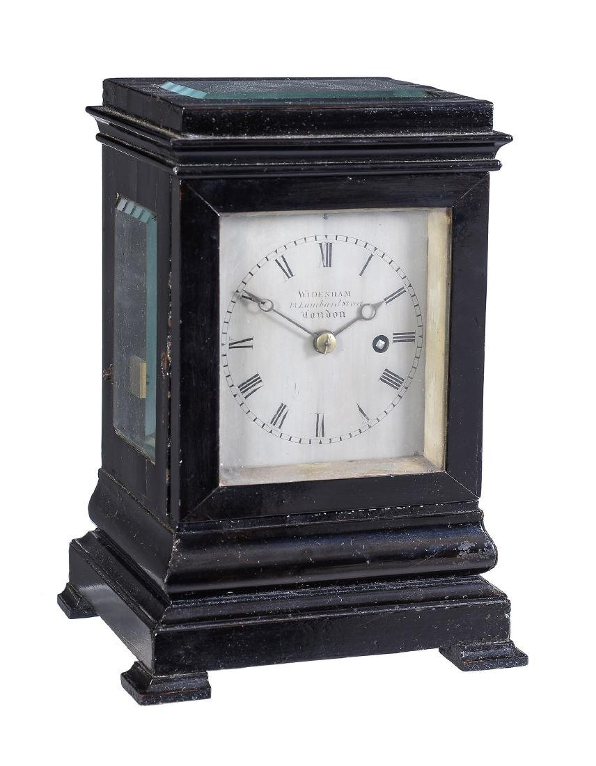 An early Victorian small ebonised four-glass mantel