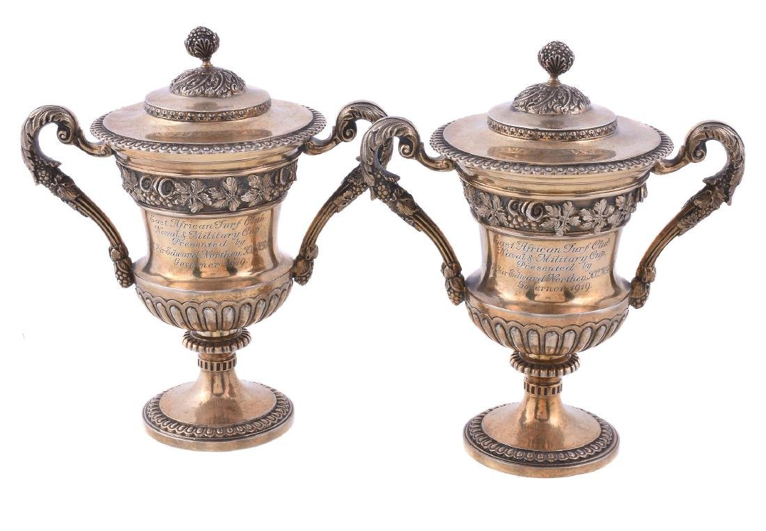 A pair of silver gilt small cups and covers by