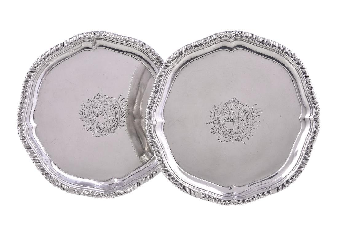 A pair of late George II silver quatrefoil waiters by