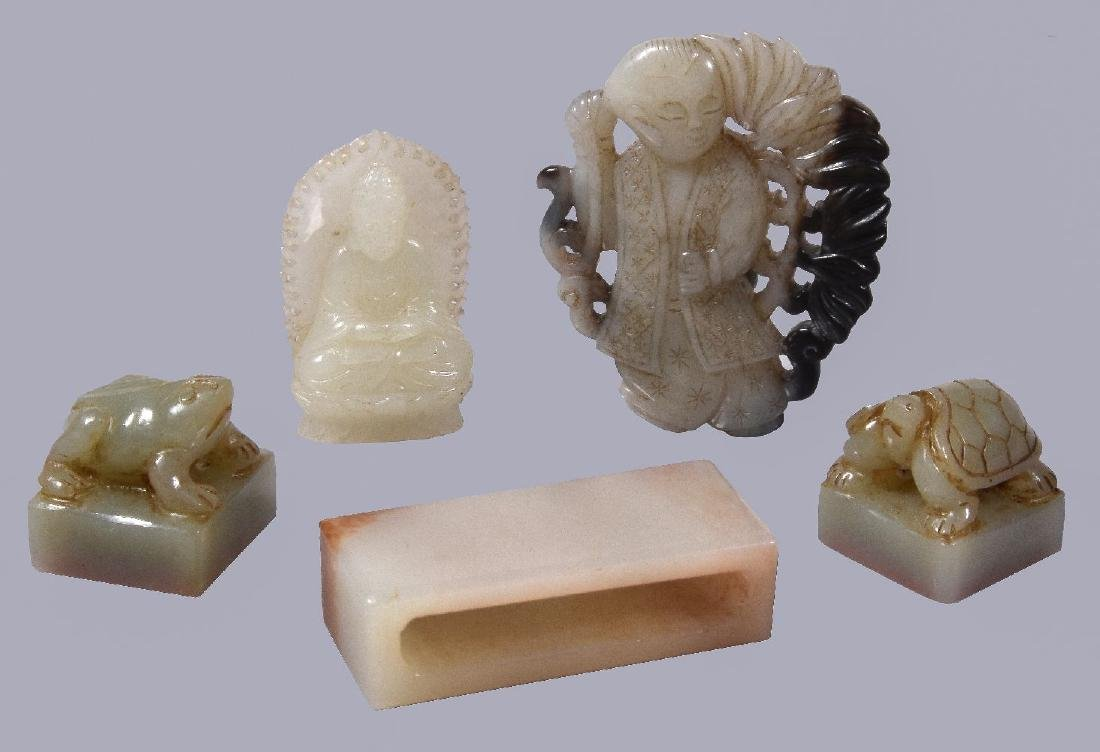A Chinese white or pale celadon jade carving of Buddha