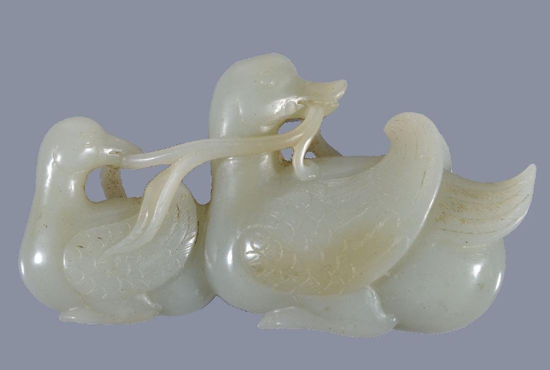 A Chinese celadon jade carving of two Mandarin ducks
