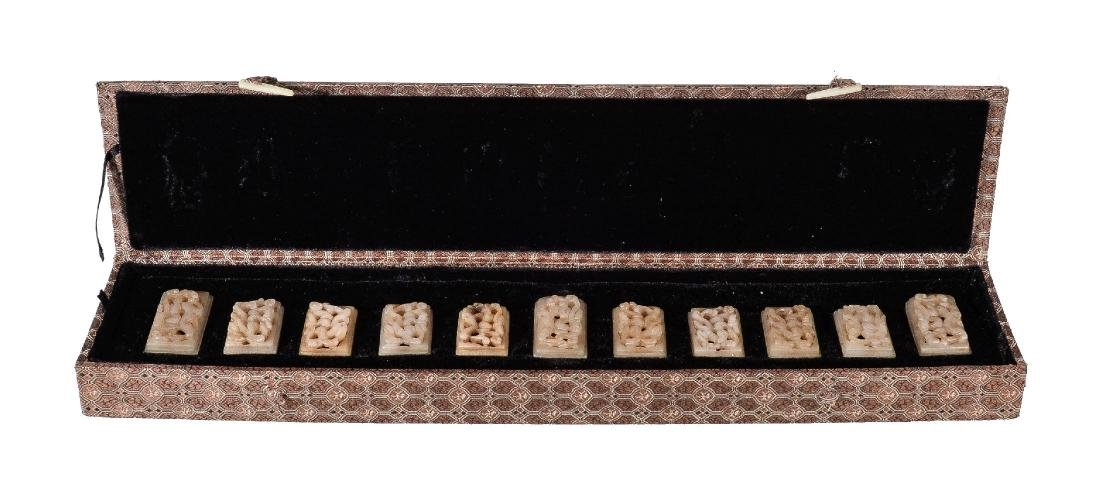 A set of eleven Chinese white and brown pierced jade - 2