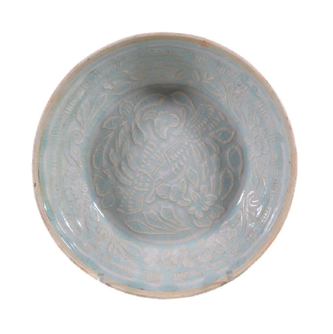 A Chinese moulded Qingbai 'phoenix' bowl