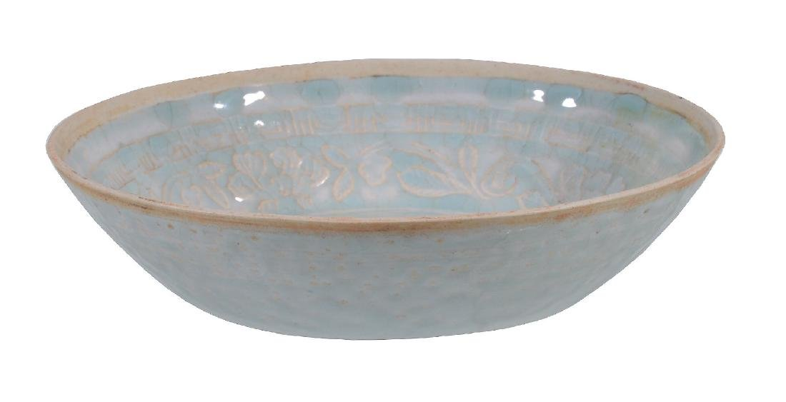 A Chinese moulded Qingbai 'phoenix' bowl - 2