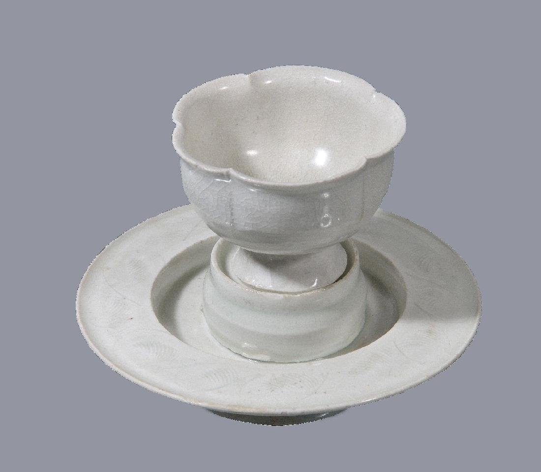 A Chinese Qingbai cup and stand
