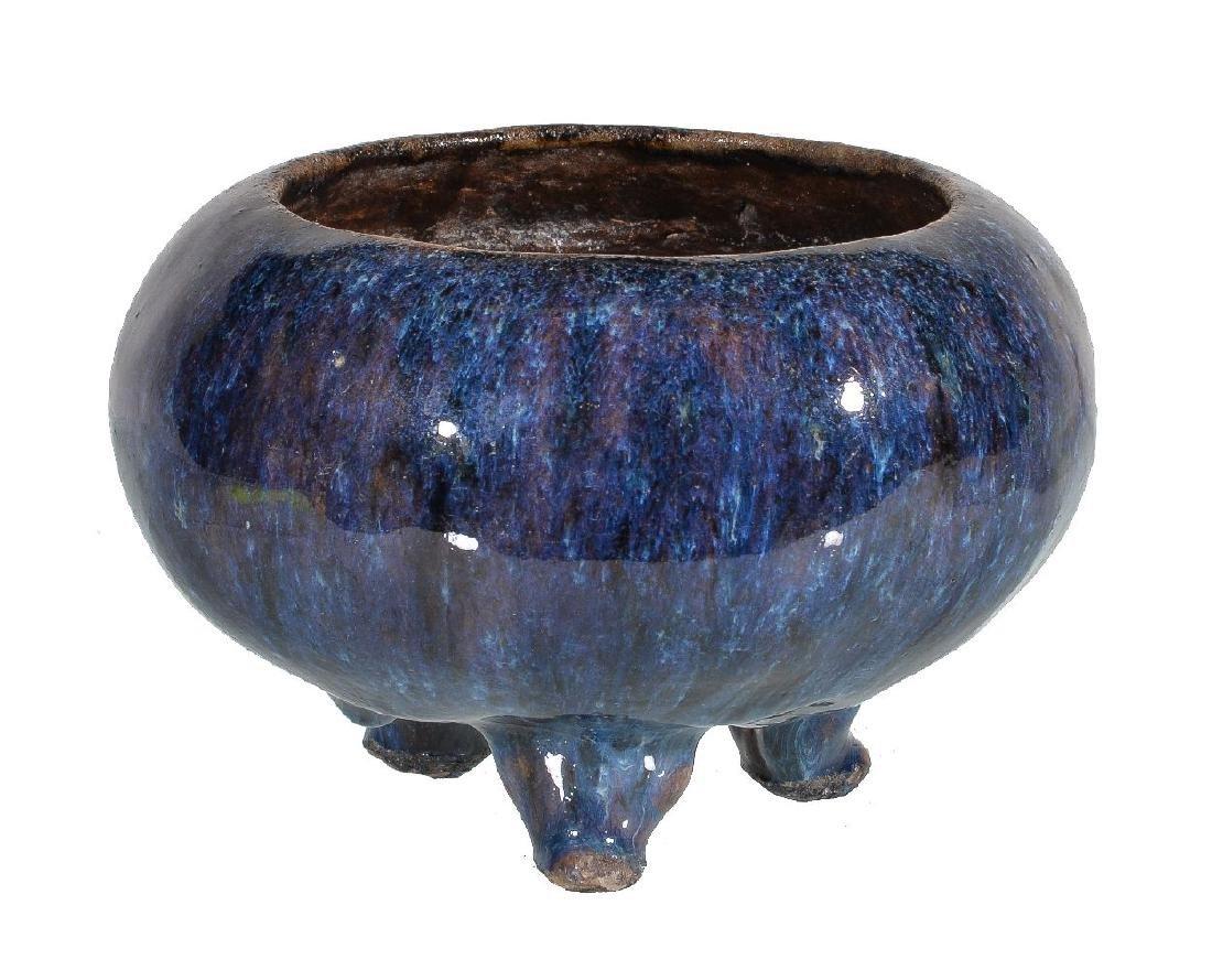 A Chinese high-fired stoneware tripod bowl