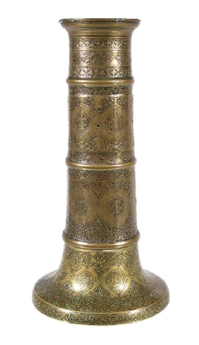 A Safavid brass candlestick