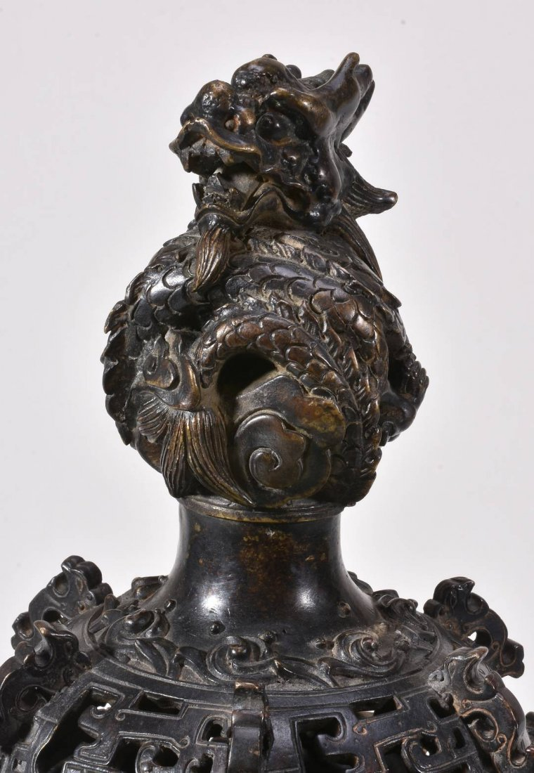 A large Chinese bronze incense-burner and cover