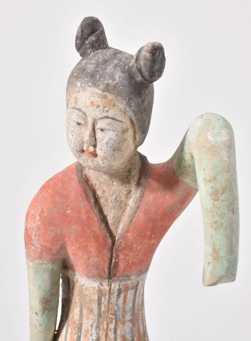 A Chinese painted pottery sleeve dancer