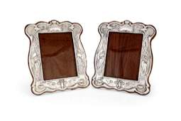 A pair of Art Nouveau silver photograph frames by