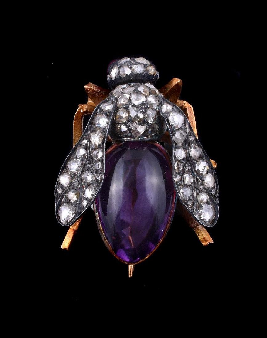 A diamond, ruby and amethyst bee brooch