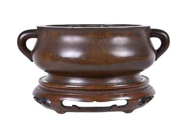 A Chinese bronze bombe censer and stand