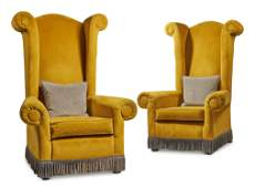 A PAIR OF YELLOW UPHOLSTERED 'CASTLE CHAIRS', BY A