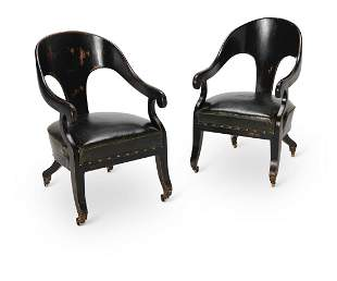 A PAIR OF REGENCY STYLE EBONISED 'ROMAN' ARMCHAIRS