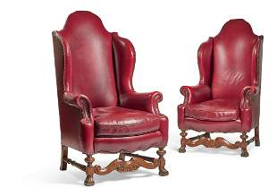 A PAIR OF VICTORIAN WALNUT AND RED LEATHER UPHOLSTERED