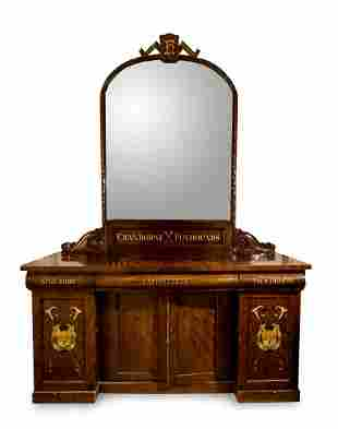 A VICTORIAN STAINED OAK AND PARCEL GILT WALL MIRROR