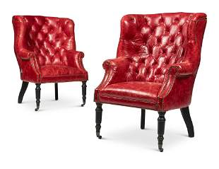 A PAIR OF LEATHER BUTTON UPHOLSTERED WING ARMCHAIRS