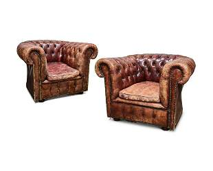 A PAIR OF BROWN LEATHER BUTTON UPHOLSTERED ARMCHAIRS