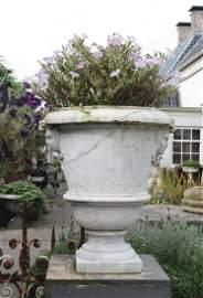 A Continental carved Carrara marble garden urn