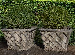 A pair of stone composition planters modelled as