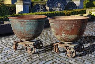 A pair of French iron planters