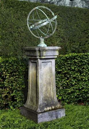 A bronze mounted carved bluestone armillary sphere