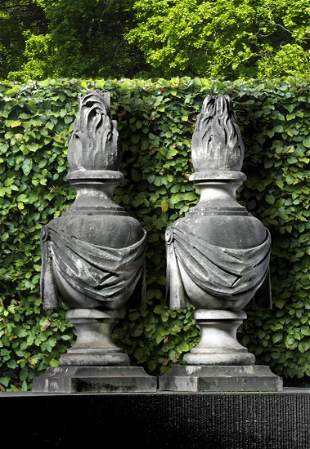 A pair of Continental carved white marble pier finials