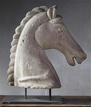 A sculpted limestone model of the head of a horse