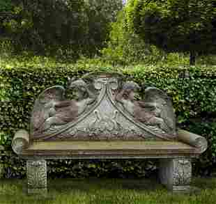 A carved limestone garden bench in Louis XIV style