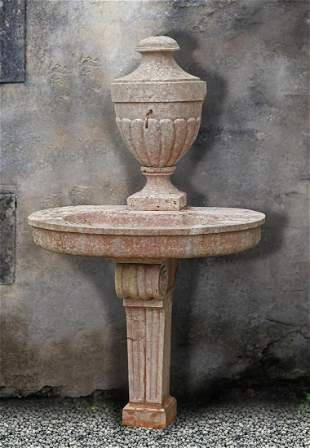 A Continental carved pink limestone fountain