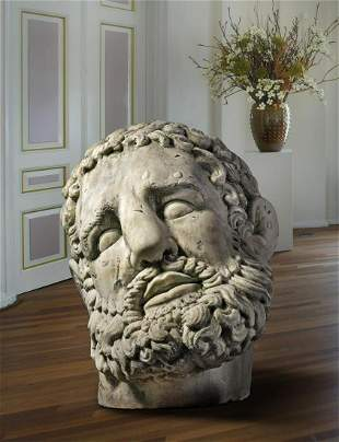 A colossal sculpted white marble model of the head of