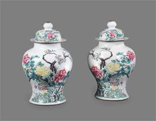 An attractive pair of Chinese Famille Rose vases and