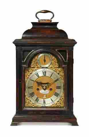 A GEORGE III EBONISED PEARWOOD TABLE CLOCK