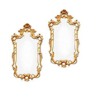 A PAIR OF CARVED GILTWOOD WALL MIRRORS IN GEORGE III
