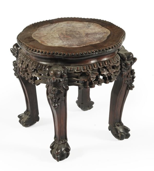 1: A Chinese hardwood table of octagonal shape carved