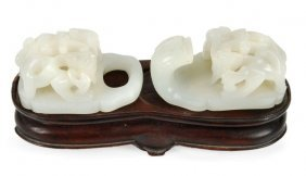 86: A Chinese twin sectioned jade buckle carved with s