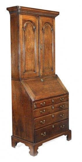 271: A George II oak bureau bookcase, circa 1740, mould