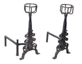 272: A pair of wrought iron fire dogs in the 17th centu