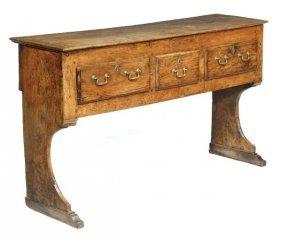 275: A George II elm and oak dresser base, circa 1750,