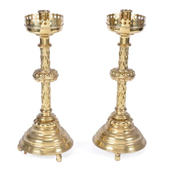 280: A pair of brass candlesticks in the Gothic style,
