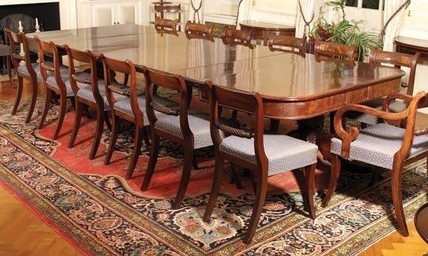 465: A George IV mahogany twin pillar extending dining