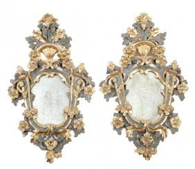 523: A pair of Italian carved, painted and parcel gilt