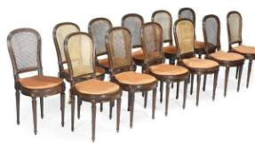 A set of twelve mahogany and  brass mounted dining